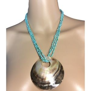 Glimmering clam shell necklace